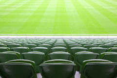 Rows of folded plastic seats in empty stadium Stock Photography