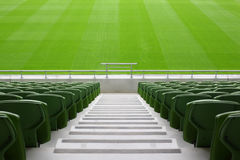Rows of folded plastic seats in empty stadium Stock Photo