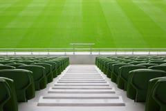 Rows of folded plastic seats in empty stadium Stock Photo