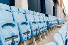 Rows with folded seats of bleachers on stadium Stock Images
