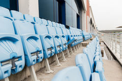 Rows with folded seats of bleachers on stadium Royalty Free Stock Images