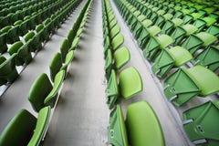 Rows of folded seats in empty stadium Royalty Free Stock Photos