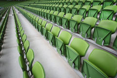 Rows of folded seats in empty stadium Royalty Free Stock Images