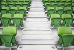 Rows of folded seats in stadium Royalty Free Stock Photo