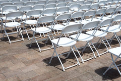 Rows of folding chairs Royalty Free Stock Photo