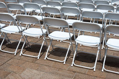 Rows of folding chairs Stock Images