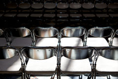 Rows of folding metal chairs Royalty Free Stock Photography