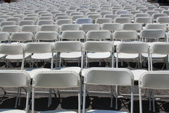 Rows of folding white chairs Royalty Free Stock Photos