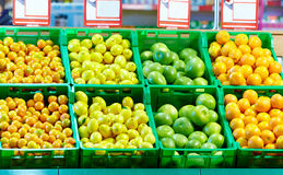 Rows of fresh citrus fruits in mall Royalty Free Stock Image