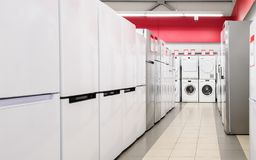 Refrigerators and washing mashines in appliance store royalty free stock image