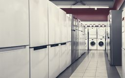 Refrigerators and washing mashines in appliance store royalty free stock images
