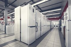 Refrigerators and washing mashines in appliance store stock photos