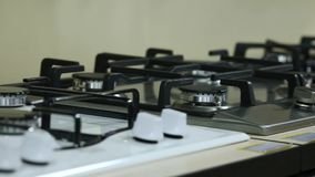 Rows of gas stoves selling in home appliance store stock footage