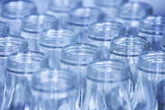 Rows of glass bottles ready for recycling, shallow depth of fiel Stock Image