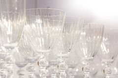 Rows of glass wine glasses for drinks.  stock photography