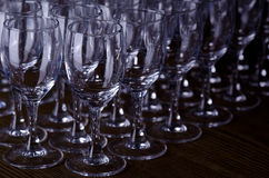 Rows of glasses. Rows of empty glasses on black royalty free stock photo