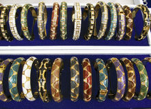 Rows of gold bangles Royalty Free Stock Photo
