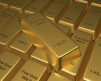 Rows of Gold Bars. Rows of goldbars in with one on top. 3D rendered reflective on white background Stock Images