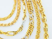 Rows of gold  chains Stock Photos
