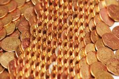 Rows of golden coins. Arranged as pattern Royalty Free Stock Image