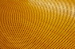 Rows of Golden Tightly Fitted Wooden Slats Royalty Free Stock Images