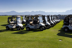 Rows of golf carts sunshine Royalty Free Stock Photos