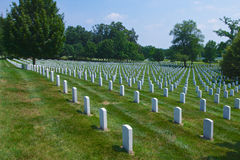 Rows of Grave Markers at Arlington. Rows of white grave markers or tombstones at Arlington National Cemetery in Washington DC Royalty Free Stock Photos