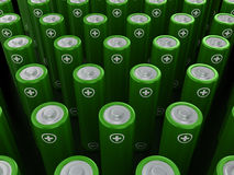 Rows of green alkaline batteries (AA) Stock Image