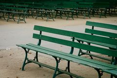 Rows of Green park Benches. Photo taken at San Francisco`s Golden Gate park, of rows of empty green park benches Royalty Free Stock Images