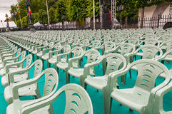 Rows of green plastic chairs outdoor celebration event Royalty Free Stock Images