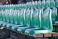 Rows of green plastic seats Stock Images