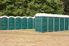 Rows of green portaloos stock images