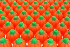 Rows of Halloween pumpkin candy Royalty Free Stock Photos