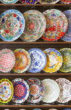 Rows of Hand Painted Turkish Plates on Shelf Stock Images