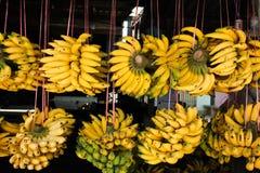 Rows of hanging yellow banana Stock Photo