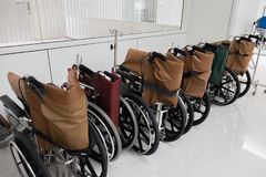 Rows of hospital wheelchair prepare for patient or disabled park Royalty Free Stock Images