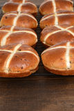 Rows of hot cross buns cooling Stock Photography