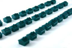 Rows of Houses. Green board game houses in three rows on a white background Royalty Free Stock Photos