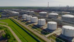 Rows of huge white gas tanks at refinery plant aerial view