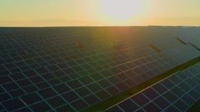 Rows of hundreds solar panels established on field