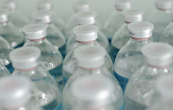 Rows of identical bottles. Photo reflects the typical, standard, conveyor, medicine, manufacturing Stock Photo