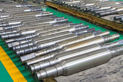 Rows of industrial roll in a factory. In a workshop Stock Photos