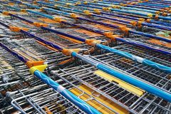 Rows of iron carts in a supermarket royalty free stock photos