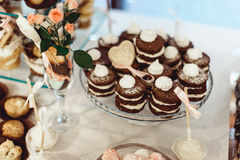 Rows of italian mignon cakes on a glass stand. Rows of coloured italian mignon cakes on a glass stand royalty free stock images