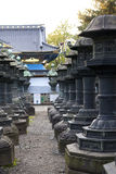 Rows of Japanese traditional stone lanterns Stock Photos