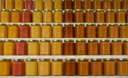Jars of honey on shelves Royalty Free Stock Images