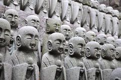 Rows of Jizo statues. Rows of concrete statues of a japanese deity name Jizo which is the guardian of children and patron deity of deceased children and aborted stock image