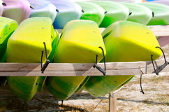 Rows of kayaks on wooden storage racks Stock Photography