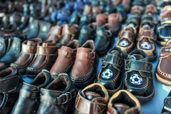 Rows of kids shoes at a swap meet Royalty Free Stock Photography