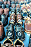 Rows of kids shoes at a swap meet Stock Images